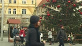 avant : BRNO, CZECH REPUBLIC, DECEMBER 21, 2018: Christmas tree luminous and shines beautiful decorated flasks red xmas ball, people family father and mother with baby carriage with infant child