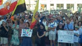farba : PRAGUE, CZECH REPUBLIC, JUNE 11, 2019: Demonstration of people crowd against the Prime Minister Andrej Babis, a banner with a draw with justice and second banner no longer Babis