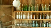 open air museum : Jar bottles with glass and carboy, traditional Moravia cottage old folk Hana. Interior of peasant and dishes glassful hut, farmhouse, house articles furniture crockery or tumblerful punch things