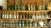 вещи : Jar bottles with glass and carboy, traditional Moravia cottage old folk Hana. Interior of peasant and dishes glassful hut, farmhouse, house articles furniture crockery or tumblerful punch things