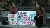 PRAGUE, CZECH REPUBLIC, OCTOBER 17, 2019: Demonstration people against Turkey banners flag sign save the Kurds, Petra Cermakova and Anna Slesingerova young girls students