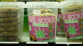 PRAGUE, CZECH REPUBLIC, SEPTEMBER 9, 2019: Cannabis cookies shop or store Prague, packaged hemp cannabidiol CBD biscuit or cracker seeds and in relieves pain, leaf symbol green, Europe Stock mozgókép