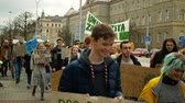 ısınma : OLOMOUC, CZECH REPUBLIC, NOVEMBER 30, 2019: Activists students, Friday for future, demonstration against climate change, banner sign the climate is rising and thats our planet, people crowd Stok Video