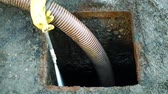 fanghi : Septic cesspool emptying pumping into pipe tank by suction hose under high pressure. The sump contains pollution sludge sewage water black wastewater and faeces plus excrements from home Filmati Stock