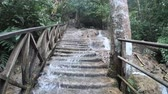 cachoeira : Water rushing over a staircase trail at Kuang Si waterfalls, Luang Prabang, Laos