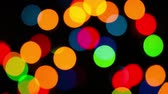 Lights garlands, abstract background. Bokeh effect. Christmas tree lights twinkling. Winter Holidays footage. Filmati Stock