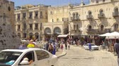 making a wish : JERUSALEM, ISRAEL - APRIL 17: The Old City of Jerusalem near the Jaffa Gate, street market, people walk in Jerusalem, Israel on April 20, 2017 Stock Footage