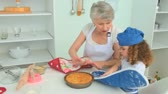 kaka : Cute little girl cooking with her grandmother