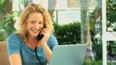 conversation : Casual woman speaking on the phone at home