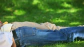 浪漫 : Couple lying chatting and laughing on the grass in the park