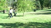 teenager : Footage in high definition of parents and children having fun in a park with a ball