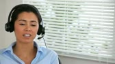 executive : Secretary answering the phone thanks to her headset Stock Footage