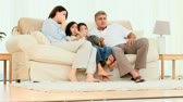 happy : Family watching tv on a couch Stock Footage