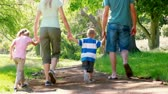 adult : Young family walking in a park