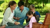 happy : Happy family eating their sandwiches in the countryside Stock Footage