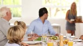 house : Family watching as mother brings turkey to table at family dinner