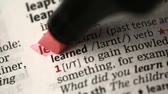 marcador : Definition of learn highlighted in the dictionary Stock Footage