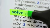 marcador : Definition of solve highlighted in the dictionary Stock Footage