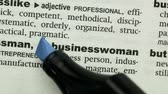 marcador : Businesswoman highlighted in blue in the dictionary Stock Footage