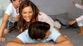 happy : Family playing together in bedroom in slow motion at 500 frames per second