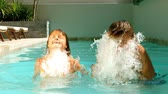 dunking : Siblings having fun in the swimming pool with a sunny day in slow motion at 500 frames per second Stock Footage