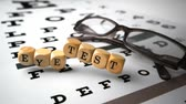 slowmotion : Dice with eye test written on it falling onto eye test next to glasses in slow motion