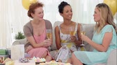 livingroom : Friends having white wine and chatting at a party at home on the couch Stock Footage
