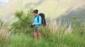 lifestyle : Active woman hiking on her own reading a map in the countryside