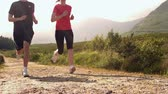 fitness : Fit couple jogging on a country trail in slow motion