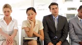 entrepreneur : Business people waiting for an interview at the office Stock Footage