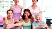 studio : Smiling group of women in fitness studio at the gym Stock Footage