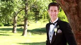 adult : Attractive groom smiling at camera  on a sunny day Stock Footage