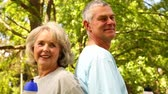 lifestyle : Retired couple exercising together outside on a sunny day Stock Footage