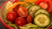 bell pepper ring : Olive oil pouring over fresh salad in slow motion Stock Footage