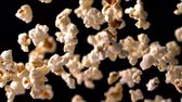 definition : Popcorn bouncing against black background in slow motion