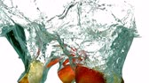 wet : Apple segments plunging into water on white background in slow motion