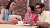 charming : Casual business team having a meeting with tablet pc in the office Stock Footage