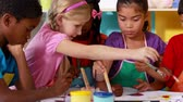 paint : Preschool class painting at table in classroom in playschool Stock Footage