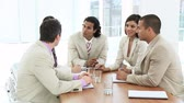 workgroup : Young  Multi ethnic Business team in a meeting Stock Footage