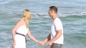 joy : Footage in high definition of couple running on the beach