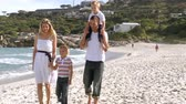 joy : Footage in high definition of happy family walking on the beach Stock Footage