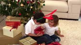 livingroom : Animation of two children opening their present in the livingroom Stock Footage