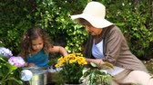 working parents : Old woman and a child gardening in the garden