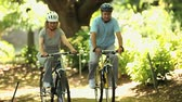 fitness : Elderly couple walking in bikes in the Park