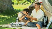 kids tent : Father and son fishing in the Park