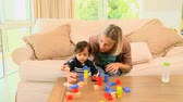 loiro : Young mother playing with her baby with building blocks Vídeos