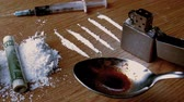 line : Rolled up note falling on white substance with lines lighter syringe and cooking spoon in slow motion Stock Footage