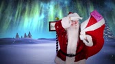 graphic : Digital animation of Santa delivering presents at the north pole