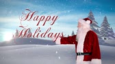 celebration : Digital animation of Santa presenting christmas message against snowy fir forest Stock Footage