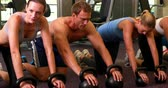 fitness : Kettlebell class getting into plank position at the gym